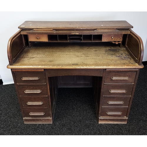 12 - Antique knee hole roll top writing desk. Designed with 9 drawers and interior storage. [100x121x68cm...