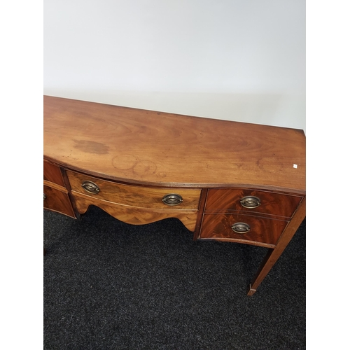 13 - A Georgian sideboard supported on square tapered legs. [94x139x49cm]