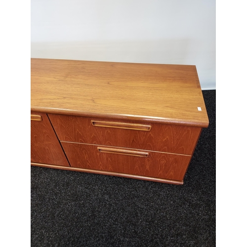 14 - A Mid century low sideboard designed with two drawers and two door storage area. [55x135x46cm]