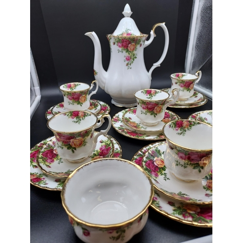 20 - A 21 Piece Royal Albert 'Old Country Roses' coffee set. [1st ]