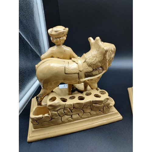 22 - A Pair of antique Eichwald pottery pipe holder figurines. [As Found]