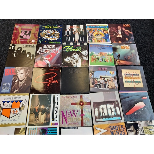 28 - A lot of records to include; ACDC, Blondie, Cult, Simple Minds, Billy Idol, Simple Minds etc