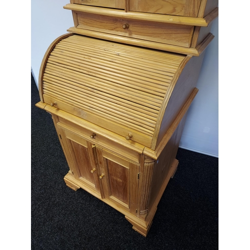 3 - Antique pine reproduction roll top writing desk with a bookcase top and storage base. [174x66x55cm]
