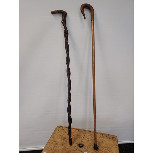 7 - Antique pine milking stool together with two various walking canes.