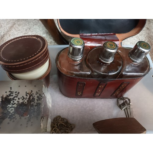 15 - Box full of odds to include drink flasks, leather drinks carrier, ornamental gun etc