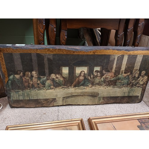 27 - A painting of Jesus with his Apostles at the last supper , painted upon wood