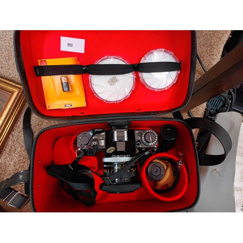 30 - Canon camera with lense within a fitted case with accessories
