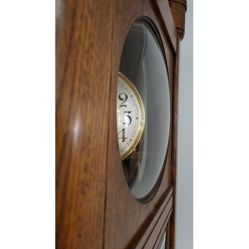 1 - An oak cased Grandfather clock, with hand carved foliage design to the upper section, silver and gol...