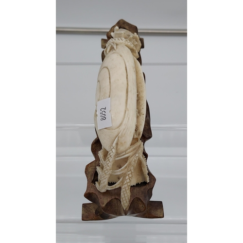 10 - Antique Chinese hand carved ivory sculpture sat upon a carved wooden stand. [18cm in length]