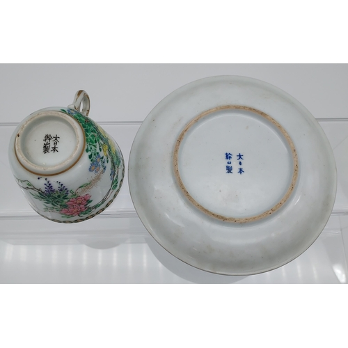 13 - A 19th century Chinese cup and saucer, hand painted with flowers and birds.
