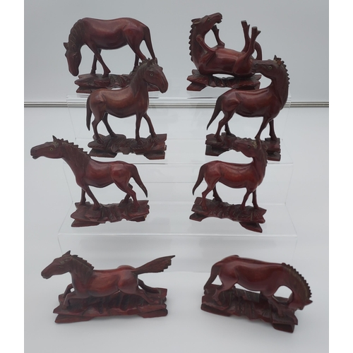 14 - 8 Chinese carved wooden horses.