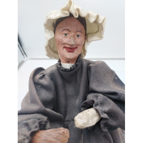 19 - A 19th Century puppet of an elderly lady seated, Dated 1840. [32cm in height]