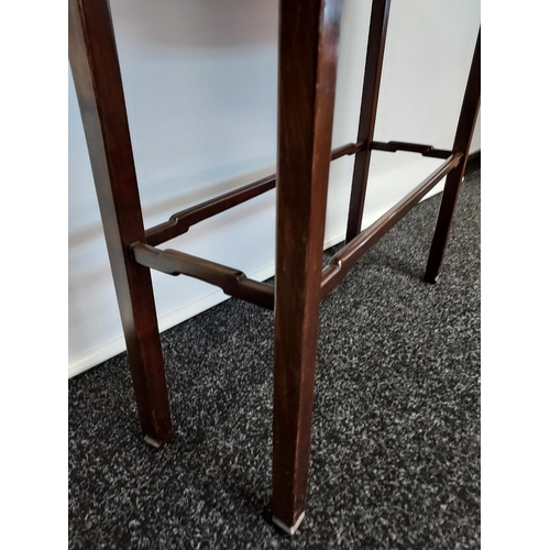 2 - A dark wood console table, with bow front single drawer, raised on square legs, united with stretche...