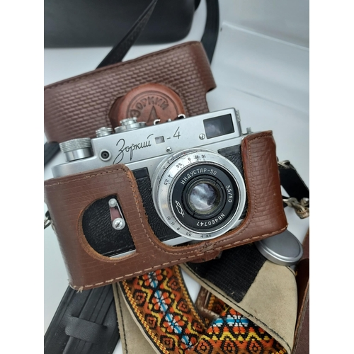 21 - A Selection of vintage cameras to include Ensign 320 Selfix bellow camera, Kodak bellow camera, Hali...