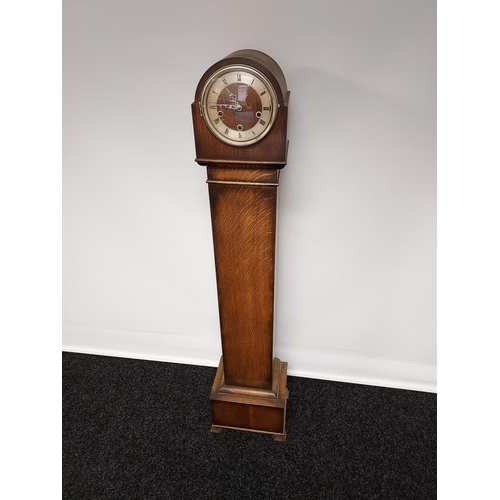 28 - A Vintage three hole Grandmother clock. Designed with an oak body. [141cm in height]