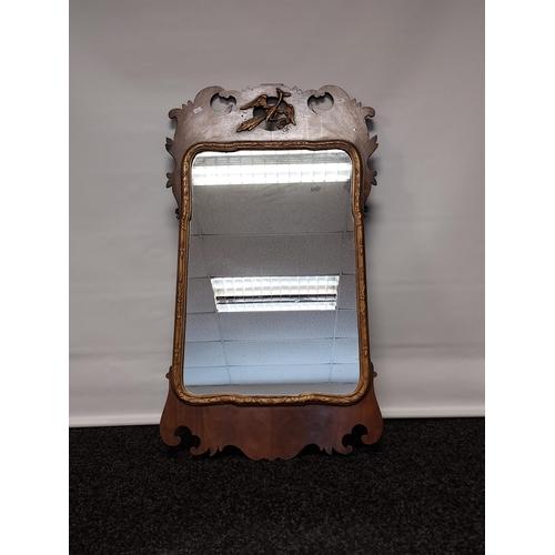 29 - A Georgian mahogany and gilt frame wall mirror. [91x53cm]