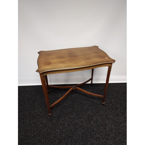 30 - A Late Victorian widow table, supported on square tapered legs upon spade feet, with X-form stretche...