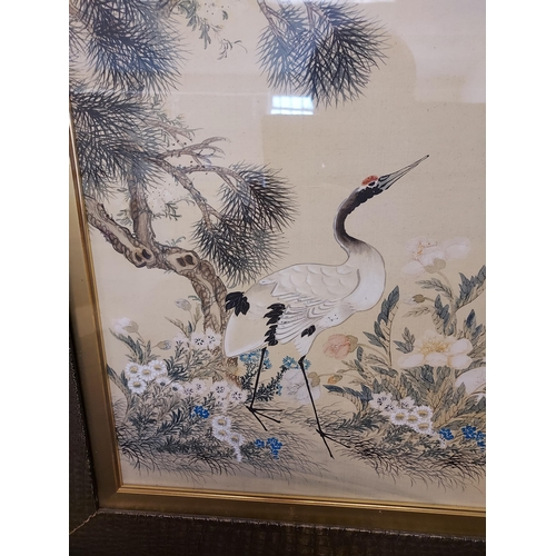 33 - A Large 18th/ 19th century Chinese/ Japanese silk painting depicting cranes surrounded by tree and f...