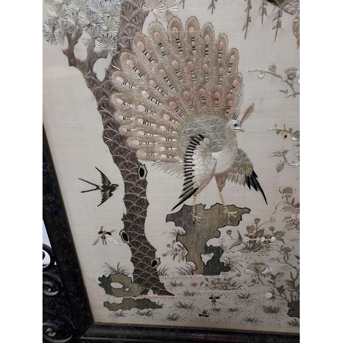 35 - An 19th century Chinese/ Japanese silk tapestry depicting various bird flying and perched. Signed by...