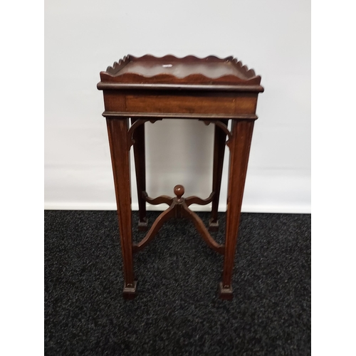 37 - Georgian drinks table, wave edging to the surround above a pull-out section to the middle, raised on...
