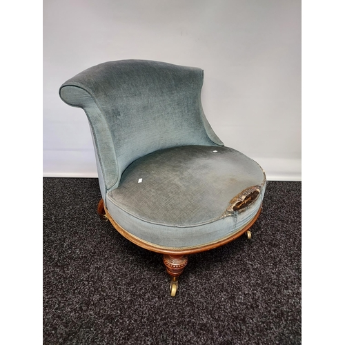 39 - A 19th century barrel chair, supported on carved turned legs and upon castors feet, filled with hors...