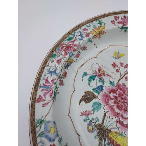 47 - A Large 19th century Japanese wall charger. Detailed with various flowers and Butterflies. [As Found...