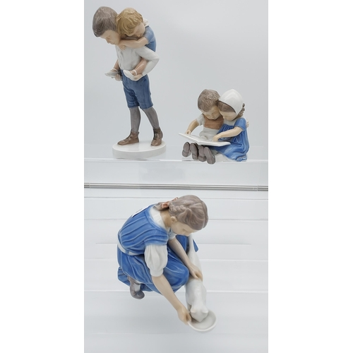 7 - A Lot of three B&G Denmark made figurines. To include Lady feeding cat, Children reading and man giv...