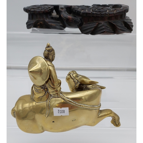 9 - An Antique heavy Bronze/ Brass Chinese man astride a water buffalo, designed with a hand carved wood...