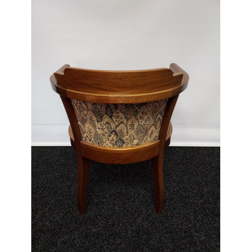 43 - An early 20th century mahogany framed bedroom tub chair, material back support and seat flanked by o...