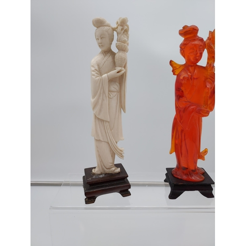44 - Amber Chinese hand carved geisha figurine together with two hand carved bone geisha figurines with w...