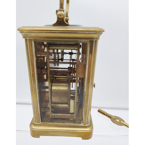 6 - Antique Brass cased and bevel glass carriage clock. Designed with an enamel dial. In a working condi...
