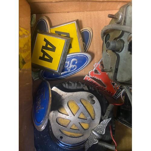 20 - A Box of vintage car badges, clocks and gauges. Includes Smiths MPH Gauge, Sabre Amperes gauge and f...