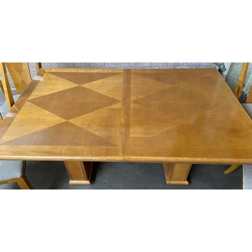 1 - A Contemporary dining table with two matching carvers and 6 chairs.
