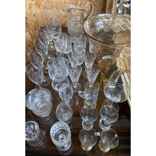 14 - A Collection of various crystal and glass wares to include amber flower vase.