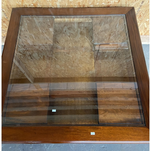 2 - A Contemporary solid wood coffee table in a square form, Designed with glass top and four small draw...