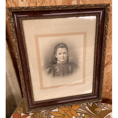 25 - Two antique photographs within ornate frames.