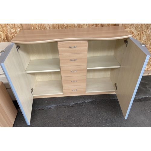 29 - A Contemporary five drawer, two door sideboard.