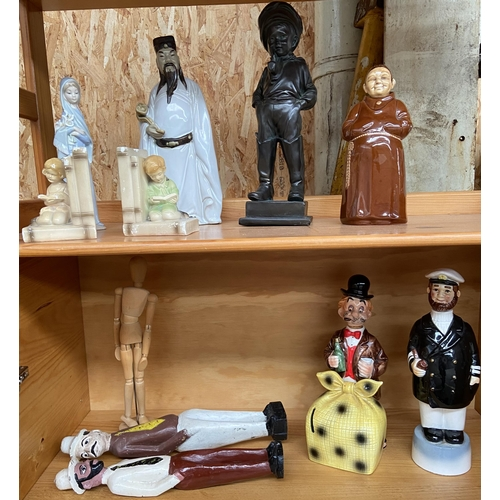 33 - A Selection of odds to include various candle holders, Ceramic figures and various character decante...