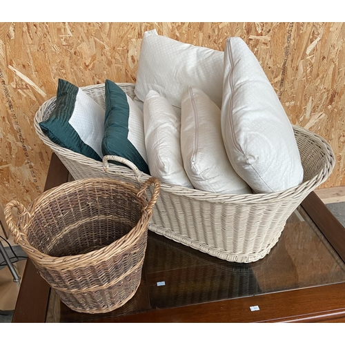 4 - Two wicker baskets and various quality cushions