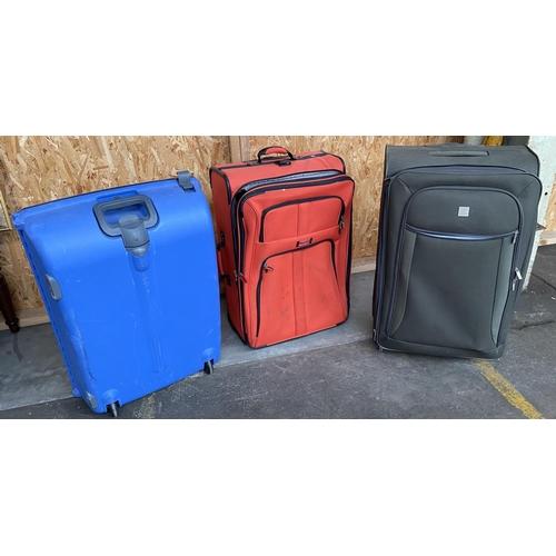 7 - Three various suit cases.