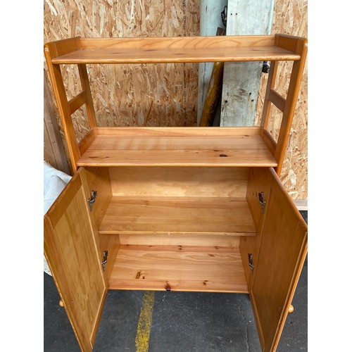 20 - A Solid pine two door bookcase.