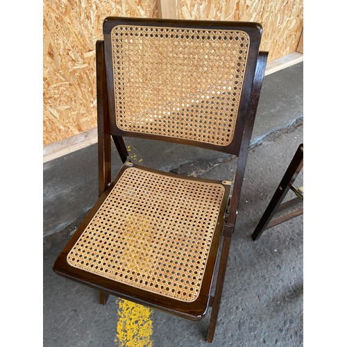 24 - Two mid century folding chairs.