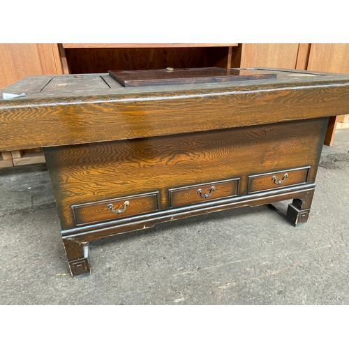 45 - A Japanese wooden tea table. Fitted with copper lined areas.
