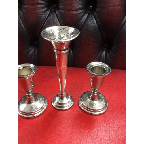 10d - 1 silver hall marked Vase and 2 white metal ones....