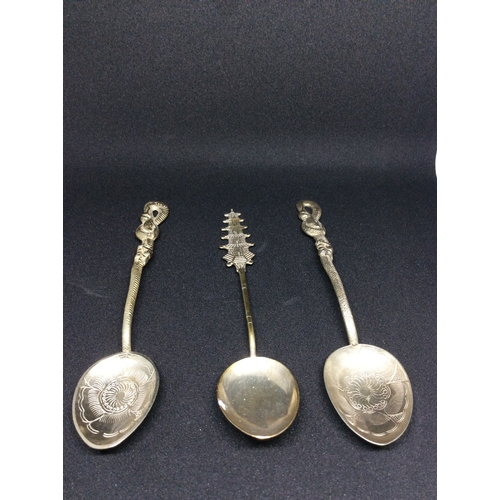 10 - 3 Chinese silver spoons with pagoda and snake design....