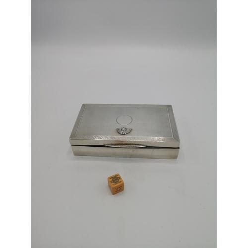 10a - Silver hall marked cigar box with cherub decoration....