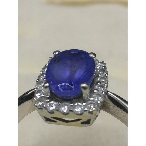 5a - 14kt white gold diamond and blue stone ring. 3.3 grams....