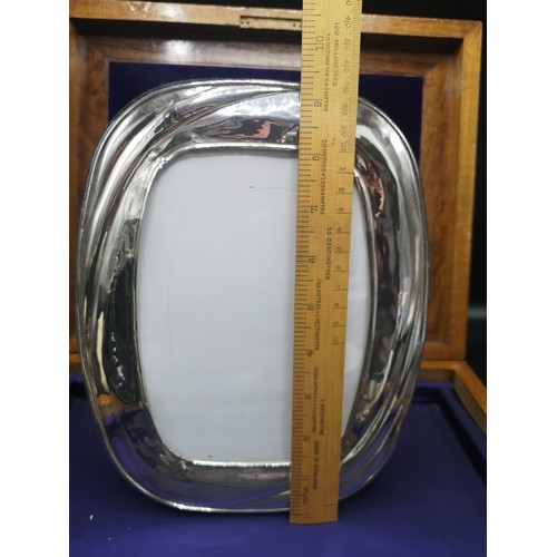 37 - Large silver Hall marked photo frame makers Robert Carr 9 inches In height by 7 inches in length.