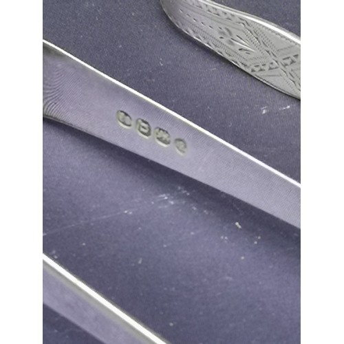 38a - 2 pairs of silver Hall marked georgian tongs.