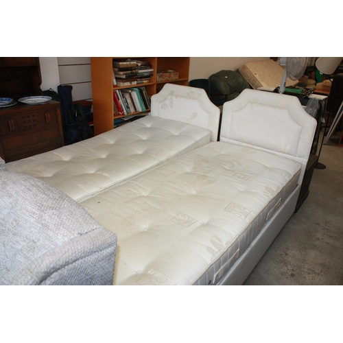 56 - Two Electric Single Beds and Mattresses...